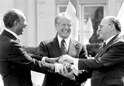 Sadat, President Jimmy Carter, and Israeli Prime Minister Menachem Begin at the signing of the Accords