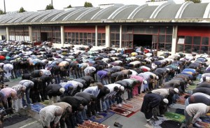 Muslims overflow outside prayers at a former fire brigade in Paris. (Photo by Reuters)