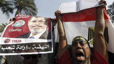 Egypt's Islamists rally to support Mursi, counter opposition