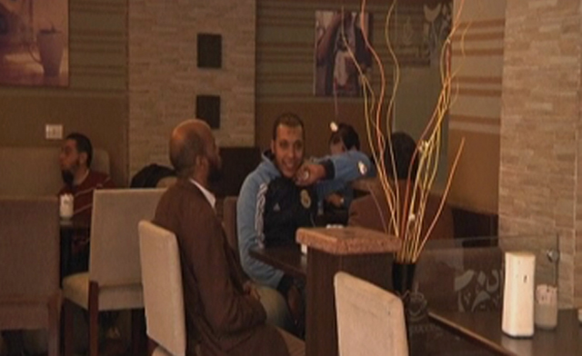 Men and women sit apart in new Cairo café