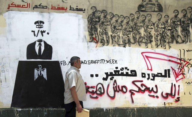 A wall sprayed with graffiti ear Tahrir Square in downtown Cairo. Reuters