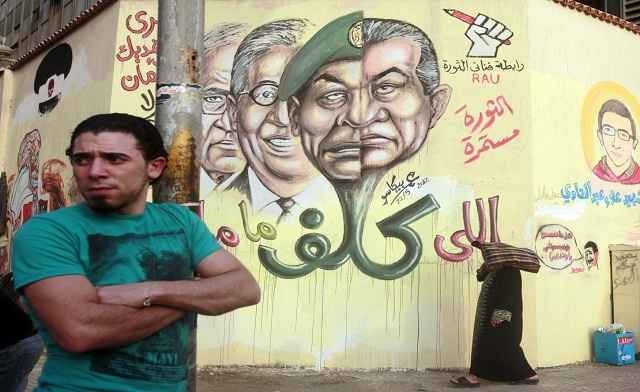 graffiti depicting former President Hosni Mubarak and several presidential candidates at Tahrir square in Cairo May 22 2012 Reuters