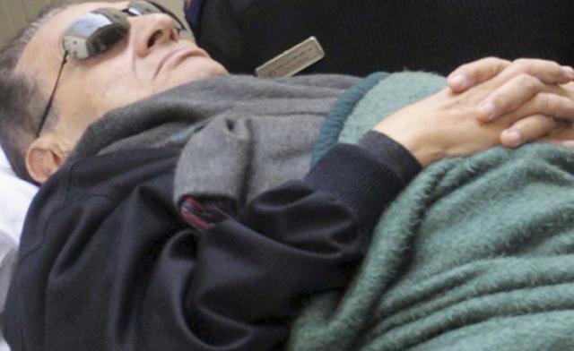 Egypt commission says Mubarak watched uprising unfold