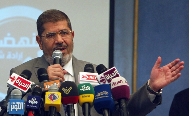 Mohammed Mursi talks during a news conference in Cairo. Reuters