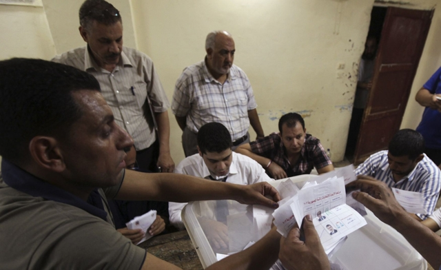 Drama mounts in Egypt after election result delayed, vote-count errors reported
