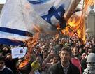 Cairo rioters burn Israeli flag