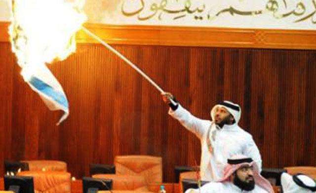 Bahraini lawmaker Osama Al-Tamimi torches the Jewish states flag in parliament. Gulf News