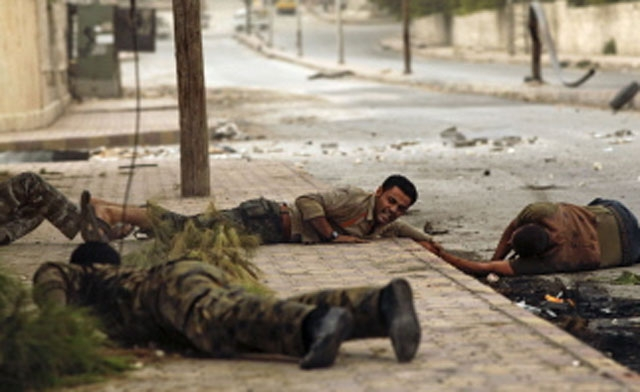 Syrian fighters capture Aleppo infantry base in latest blow to the Assad regime