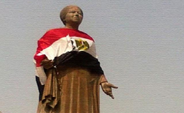 Statue of Egypt's famed classical singer gets burqa, flag makeover