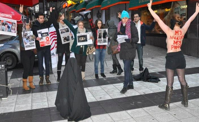 Members of the Iranian Organization Against Violence on Women in Iran dedicated their action to International Womens Day femen.org