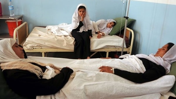 Afghan schoolgirls lie in bed after admission to hospital with symptoms of poisoning -file. AFP