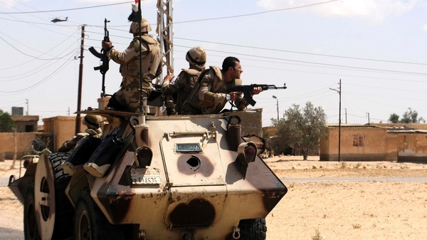 Soldiers in military vehicles Reuters