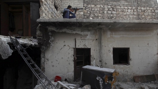 A Syrian Army fighter aims his rifle in Aleppos Karm al-Jabal district Reuters