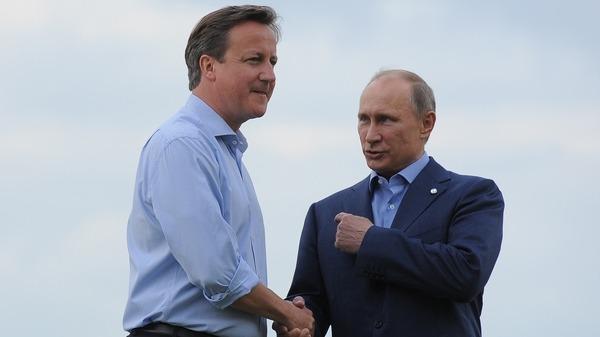 British PM David Cameron L and Russian President Vladimir Putin AFP