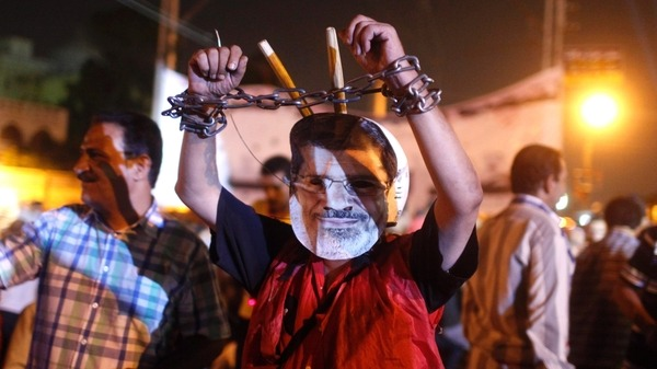 An anti-Mursi protester wears a mask Reuters