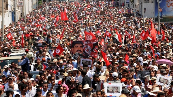 Tunisians join the funeral of opposition leader Mohammad al-Brahimi AFP