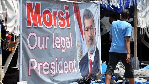 a portrait of deposed president Mohamed Morsi outside Rabaa al-Adawiya mosque. AFP
