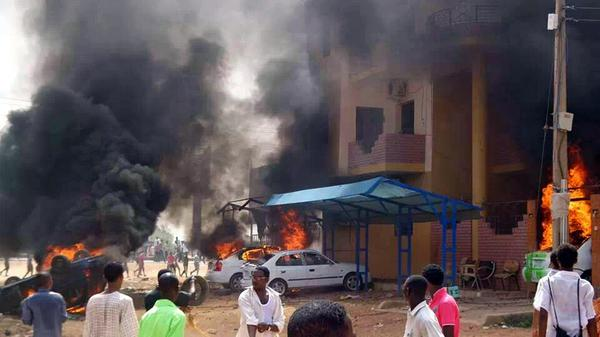 Cars burn during protests in Khartoum Reuters
