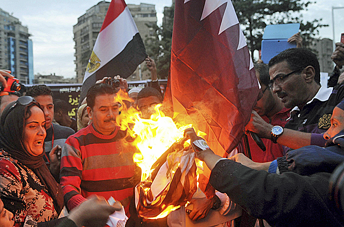 Protesters gather outside Qatar's embassy in Cairo