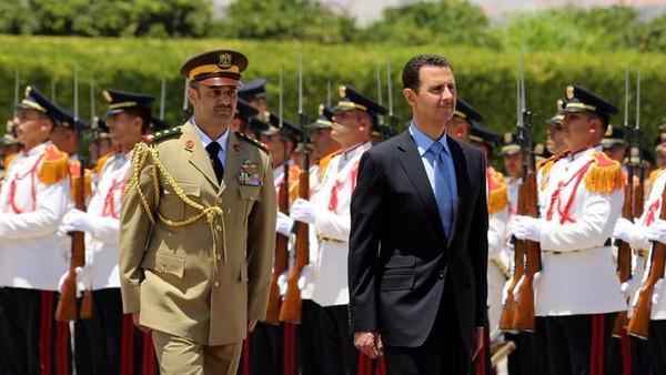 President Bashar al-Assad reviewing the honor guard ahead of being sworn Reuters